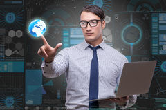 The young businessman in global business concept Stock Image