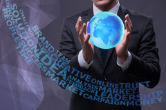 The young businessman in globalisation concept holding earth. Young businessman in globalisation concept holding earth royalty free stock images