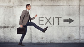 Young businessman going to the exit Royalty Free Stock Photos