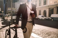 Young businessman going to work by bike stock photography