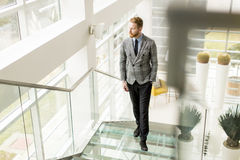 Young businessman going up the stairs Royalty Free Stock Photos
