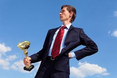 Young businessman  with a golden cup Royalty Free Stock Image