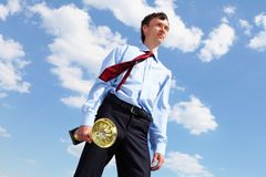 Young businessman  with a golden cup Royalty Free Stock Photography