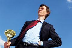 Young businessman  with a golden cup Stock Image