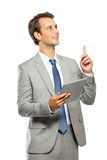 Young businessman got an idea after reading an article on tablet Stock Images