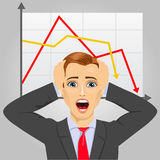 Young businessman grabbing his head in economic crisis with line graph showing negative trend stock illustration
