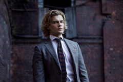 Young businessman in a gray suit, business style Royalty Free Stock Photo