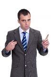 Young  businessman in a gray suit rejecting the responsibility a Stock Photos