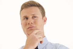 Young businessman with hand on chin. Portrait of young businessman thinking with hand on chin Stock Photos