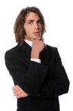 Young Businessman With Hand on Chin Royalty Free Stock Photos