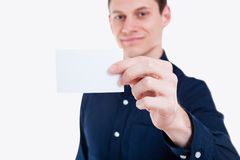 Young businessman handing card Stock Photography