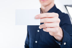 Young businessman handing card Stock Photo