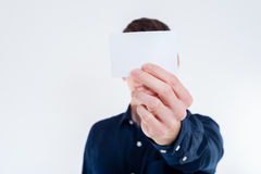 Young businessman handing card Stock Images