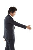 Young businessman for a handshake Stock Image