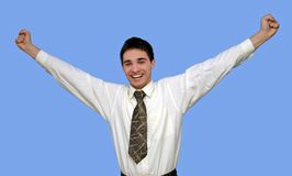Young businessman happy. With outspread hands,isolated on blue Royalty Free Stock Image