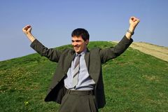 Young businessman happy. Young businessman very happy,with hands in the air Royalty Free Stock Image