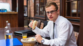 The young businessman has breakfast in the restaurant. Royalty Free Stock Photo