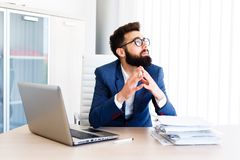 Young Businessman Has Very Stressful Day At Work. Young Sleepy Business Man Sitting At Workplace - In office Royalty Free Stock Photo