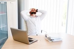 Young Businessman Has Very Stressful Day At Work. Young Sleepy Business Man Sitting At Workplace - In office Stock Images