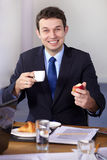 Young businessman having a break during meeting Royalty Free Stock Photography