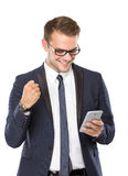 Young businessman having good news while looking at his handphon Royalty Free Stock Image