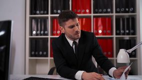 Young businessman having head pain during work in office stock video