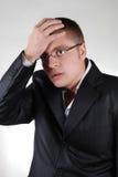 Young businessman having a headache Stock Image