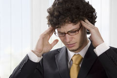 Young businessman having a headache Royalty Free Stock Image