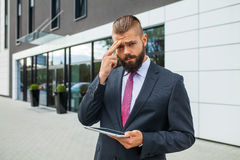 Young businessman having headache because of problems at work. Young businessman having headache because of problems at work stock images