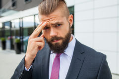 Young businessman having headache because of problems at work. Young businessman having headache because of problems at work royalty free stock photography