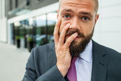 Young businessman having headache because of problems at work. Young businessman having headache because of problems at work stock photo