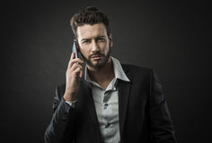 Young businessman having a phone call Stock Image