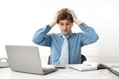 Young businessman having a problems Stock Photography