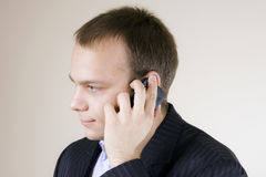 Young businessman having serious communication  Stock Images