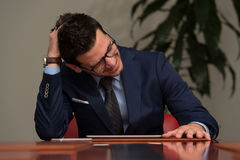Young Businessman Having Stress In The Office Royalty Free Stock Photo
