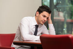 Young Businessman Having Stress In The Office Stock Photos