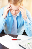 Young businessman with headache. Portrait of a young businessman with headache stock image
