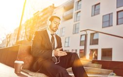 Businessman with headphone and Tablet PC royalty free stock images
