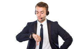 Young businessman with a headphone watching his watches Stock Photos
