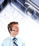 Young businessman with headphones Stock Images