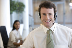 Young businessman with headset Royalty Free Stock Images