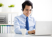 Young businessman with headset working in office Stock Photos