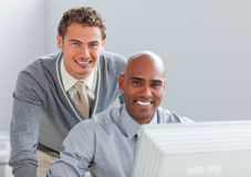 Young businessman helping his colleague Stock Image