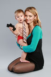 Young businessman on her mother hands Royalty Free Stock Photography