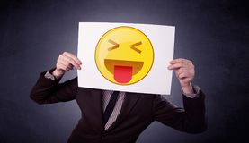 Businessman holding paper with emoticon Royalty Free Stock Images