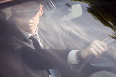 Young businessman in his car Royalty Free Stock Image