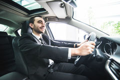 Young businessman in his car. Driver of luxuty car. Handsome man drive car. Royalty Free Stock Photo
