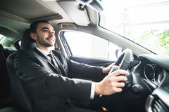 Young businessman in his car. Driver of luxuty car. Handsome man drive car. Stock Photos