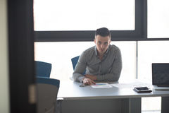 Young businessman at his desk in office Stock Photography