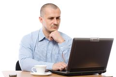 Young businessman at his laptop Stock Photos
